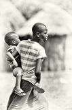 Ghanaian boy carries his little brother Stock Photo