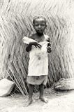 A Ghanaian boy with an empty bottle of water Royalty Free Stock Image