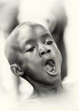 A Ghanaian boy screams Stock Image