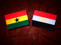 Ghanaian flag with Egyptian flag on a tree stump royalty free stock photo