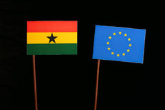 Ghanaian flag with European Union EU flag isolated on black. Background Stock Images
