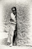 A Ghanaian girl poses near the tree Royalty Free Stock Photos