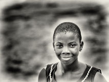 Ghanaian girl smiles for the camera Royalty Free Stock Image
