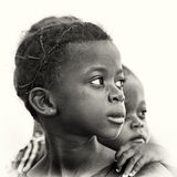 Ghanaian girl watches on her left Royalty Free Stock Image