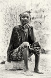 A Ghanaian lady sits on the stone Stock Images