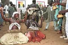 Ghanaian men dancing ritual dance to please gods. Ghana, district of Savelugu Nanton, North Ghana region, place of Savelugu: on the occasion of the opening of royalty free stock image