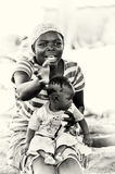 A Ghanaian mother takes care of her babies Royalty Free Stock Photography