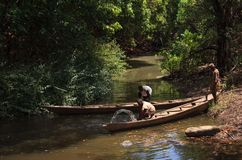 Ghanaian people and native style canoe Stock Photography
