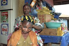 Ghanaian woman at barber shop and grocery store