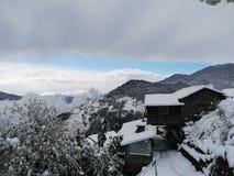 Ghandruk - μόνο χάστε τον ήλιο όταν αρχίζει στο χιόνι στοκ εικόνες