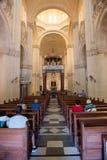 Interior of the catholic church of Ta Pinu, Malta. GHARB, GOZO, MALTA - AUGUST 22, 2017: People praying in theTa Pinu Roman Catholic minor basilica church and Stock Image