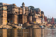 Ghats in Varanasi. A view of the ghats in Varanasi, India at sunrise, taken from a boat in the Ganges River Royalty Free Stock Images