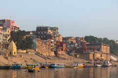 Ghats in Varanasi. A view of the ghats in Varanasi, India at sunrise, taken from a boat in the Ganges River Stock Image