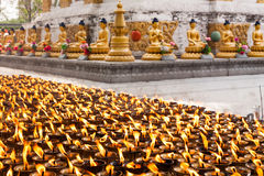 Ghee lamps and pagodas Royalty Free Stock Photography