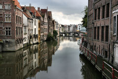 Ghent. Beautiful Belgian town of Ghent and its reflection in river Leie water. Gloomy weather royalty free stock photo