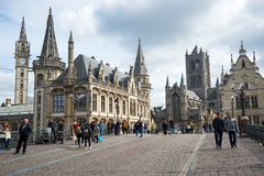 The Sint Michielsbrug bridge in Ghent, St Nicholas Church and Belfort, Belgium. stock images
