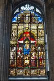 Stained glass window of the Saint Nicholas` Church in Ghent, Belgium. Ghent, Belgium - April 16, 2017: Stained glass window of the Saint Nicholas` Church in Stock Photos