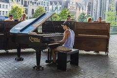 Young man playing the piano in Ghent, Belgium Stock Photography