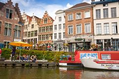 Ghent in Belgium. Ghent, Belgium - August 14, 2015 - Old colorful traditional houses and people along the canal Royalty Free Stock Photography