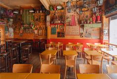 Empty restaurant in mexican style with tables and antique decoration. GHENT, BELGIUM - MAR 30, 2018: Empty restaurant in mexican style with tables, lanterns and royalty free stock photos