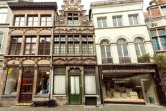 Geometry of historical street with shops in old town buildings. GHENT, BELGIUM - MAR 30, 2018: Geometry of historical street with shops in old town buildings Stock Photography
