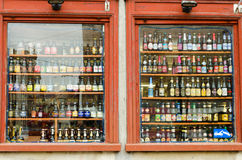 Ghent. BELGIUM - OCTOBER, 25: Showcase with many bottles of Belgian beer, on October 25, 2013, in ,  Belgium. Beer in Belgium varies from pale lager to lambic Stock Photography