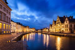 Ghent canal, Graslei and Korenlei streets in the evening. Ghent, Stock Photo
