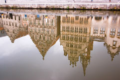 Ghent's historic buildings reflection in Leie river Stock Photos