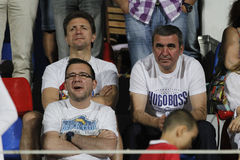 Gheorghe Hagi and Gheorghe Popescu. Former Romanian footballers watching football game Stock Images