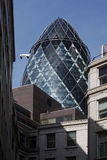 The Gherkin. Building amongst older buildings. ST Mary Axe Royalty Free Stock Images