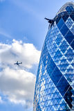 Gherkin with clouds Stock Images