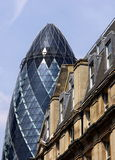 The Gherkin contrasted with vintage buildings Royalty Free Stock Photo