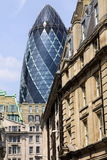 The Gherkin contrasted with vintage buildings Stock Photo
