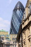 The Gherkin contrasted with vintage buildings Stock Images
