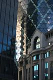 Gherkin in London. The Gherkin building in the city of london, with great reflections and geometry royalty free stock image