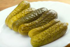 Gherkin pickles. Close up with washed away by back background Stock Photography