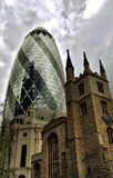 Gherkin and Saint Andrew Undershaft church Royalty Free Stock Photos