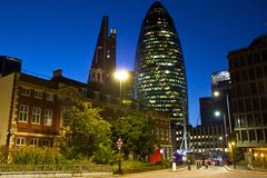 Gherkin and a street in London at night. Gherkin building in London at night Stock Photos