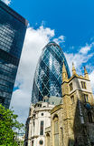 Gherkin tower and St. Andrew Undershaft Stock Images