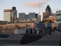 Gherkin and war ship. Old war ship in London stock image