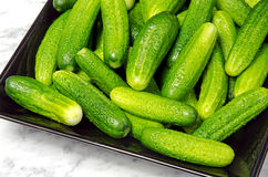 Gherkins on a black plate Stock Photo