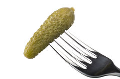Gherkins on fork Stock Photo