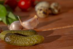 Gherkins and other edibles on a rustic background royalty free stock images
