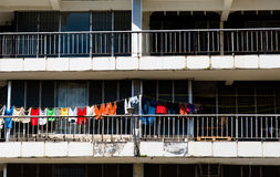Ghetto, Belize City. Motley clothes hanging on the balcony, ghetto, Belize City Royalty Free Stock Images