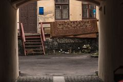 Ghetto courtyard. With door windows carpet red cat through the gate Royalty Free Stock Photography