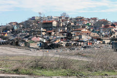 Ghetto. House among the mountains of garbage in a slum area Royalty Free Stock Photo