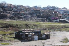 Ghetto. House among the mountains of garbage in a slum area Stock Photo