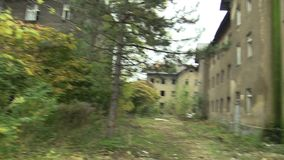 Ghetto poor in Prerov, Skodova street with abandoned former Gypsy ghetto. Gypsies, houses overgrown with vegetation, trash, mess and litter Europe, European stock footage