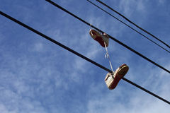 Ghetto Prank. Sneakers thrown over a telephone line Stock Photos
