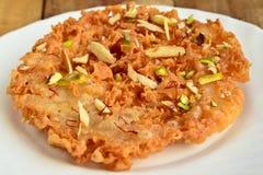 Ghevar dolce indiano Fotografie Stock